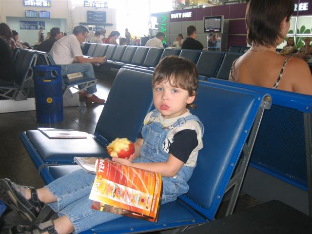 """952f163a5 Finally through passport control and seated with all of our carry-on  luggage, he could hardly believe it when we said """"see-CHESS"""" (now). He ate  it down to ..."""